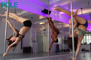 Ladies practising their pole-dancing