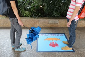Decal designating an umbrella sharing zone at Khatib MRT Station