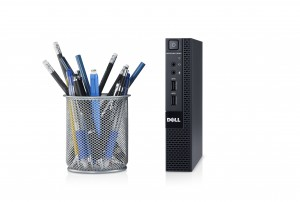 Dell OptiPlex 9020 Micro desktop computer without base next to a cup full of pens and pencils.